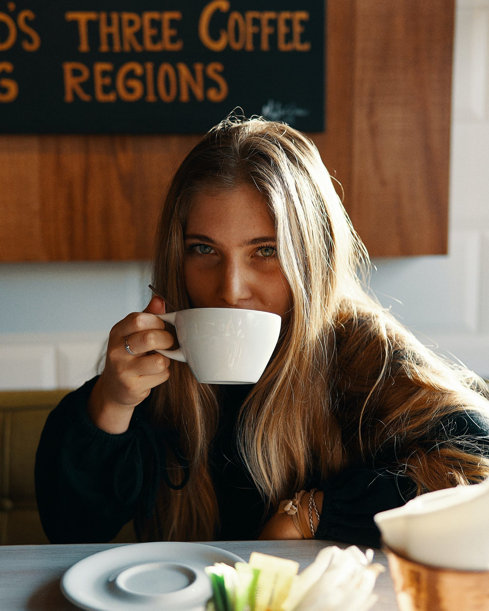 A woman and a cup of coffee