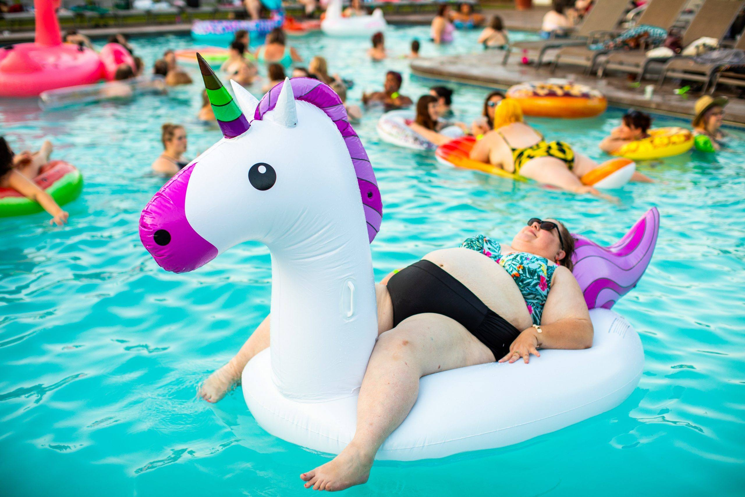 Image of woman in the pool concerning about obesity