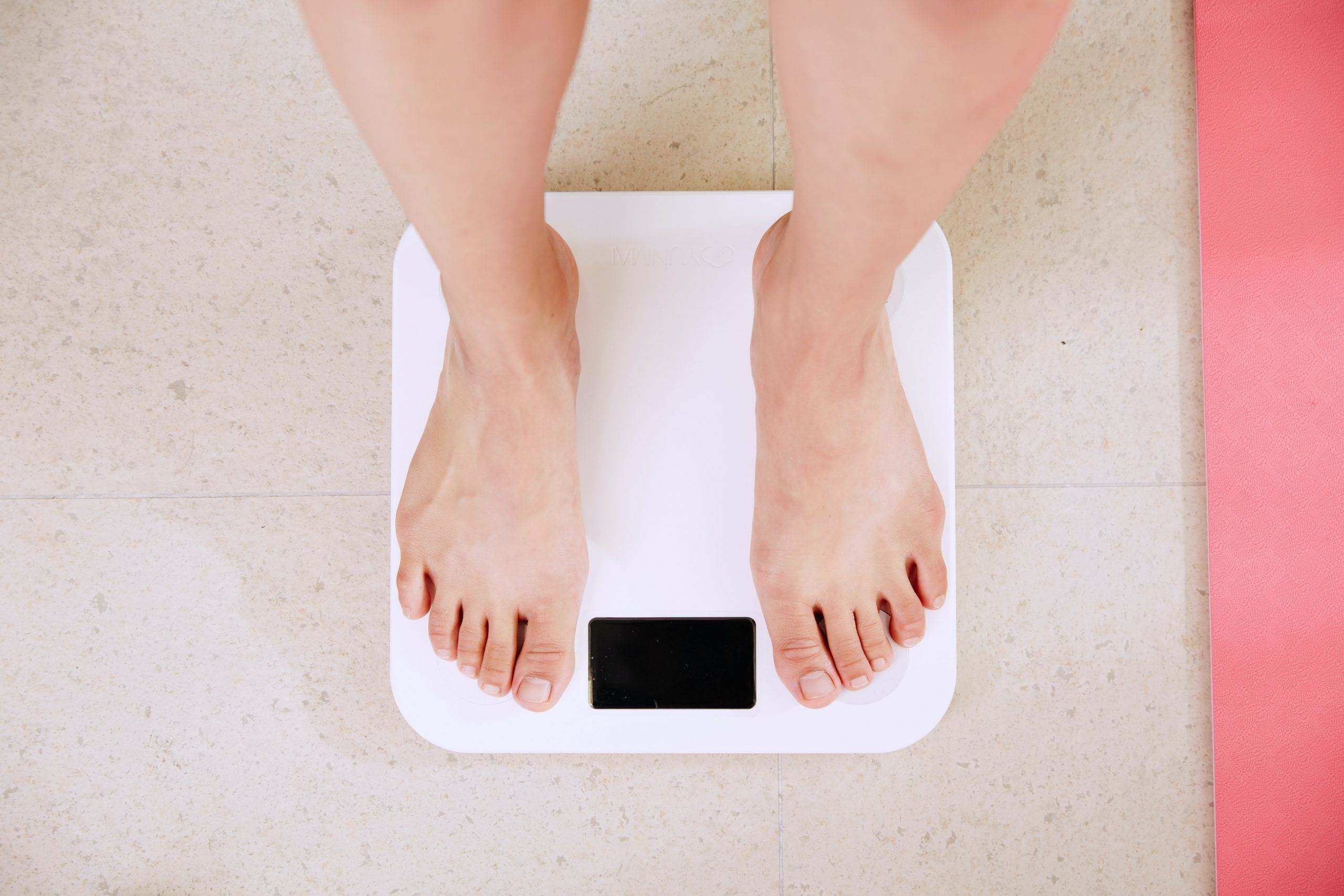 Image of man on a scale concerning about obesity