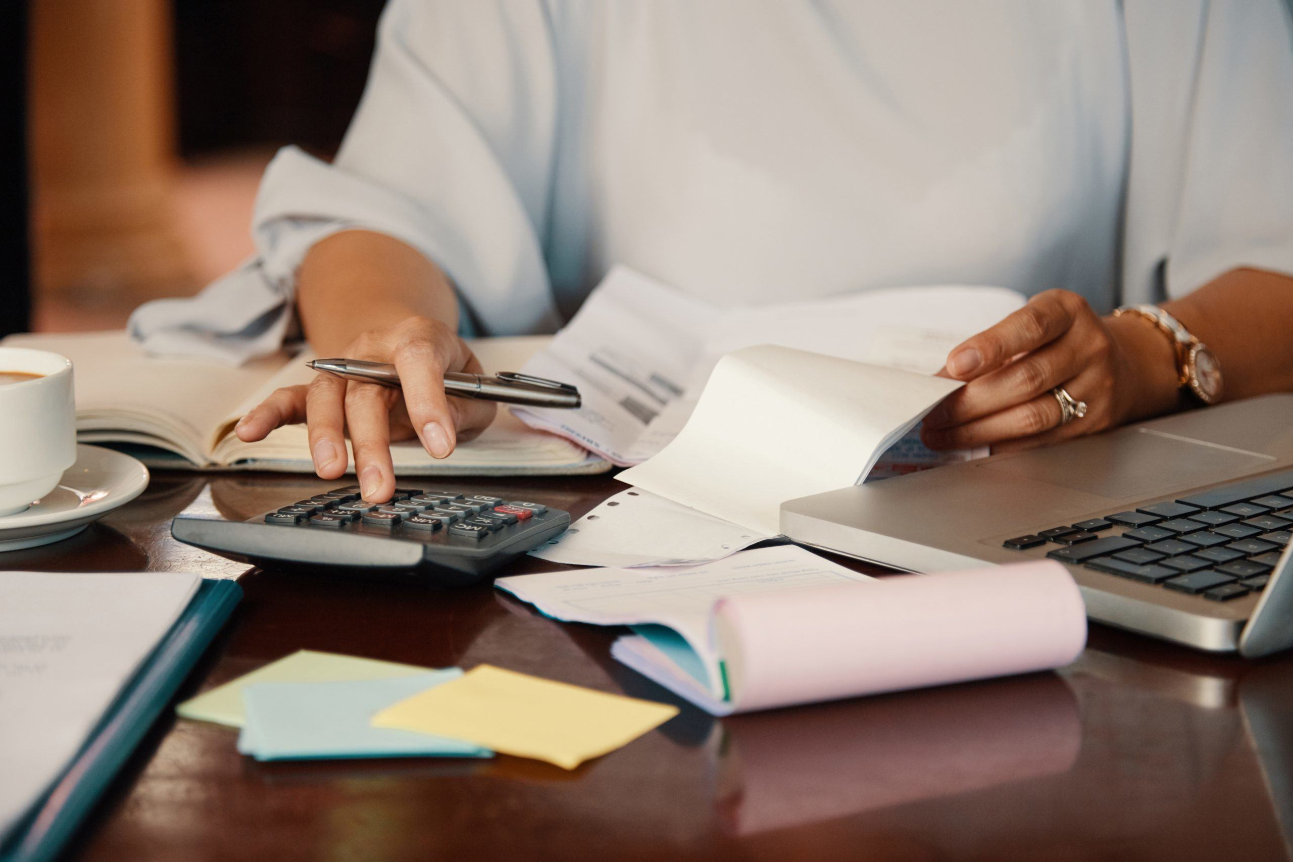 Entrepreneur working with bills and documents, avoid Spending on Non-necessities