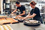people working in a restaurant kitchen