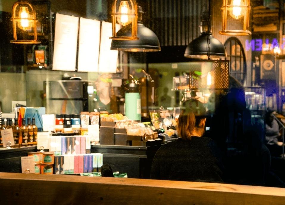 Woman sitting in a Restaurant